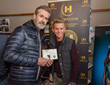 Actor Ruppert Everett visit Haracoin at the Music Lodge Gifting Suite during the Sundance Film Festival and receives Haracoin's Crytocurrency.