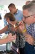 Customers lighting up cigars at public mixer