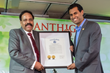 Senator Vin Gopal handing over to Santhigram CEO Dr. Gopinathan a proclamation from combined Legislature (Senate & General Assembly) honoring Santhigram as a superb Holistic Healthcare Organization