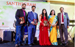 santhigram founders honoring with excellence awards to its employees Nishad, Meenu and Pradeep who have completed 5 years of dedicated service with Santhigram USA