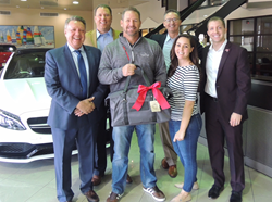 Mike Strube receiving the Big Game Sweeps package at Crown Eurocars press release by CK Advertising - Francis Mariela
