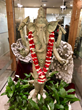 Statue of Ganesha with crystals and lei from Hawaii
