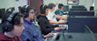 high school students at computers with headsets play internet games
