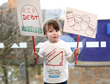 Sebastion Duncan (aged 2) protests to make financial education compulsory in UK primary schools