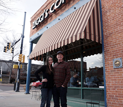 Longtime Ziggi's employee, Chris Manwell (right), and his partner Lindsey Martin (left), stand outside of the original Ziggi's Coffee location in Longmont, Colorado.