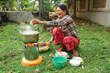 An African Clean Energy Customer in Cambodia with her ACE 1 Cookstove.