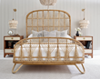 The Ara Bed features woven rattan detailing and a natural finish.