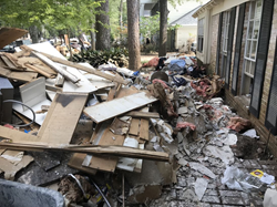 The devastating aftermath of Hurricane Harvey in a Houston neighborhood.