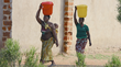 Women Carrying Water in Zambia
