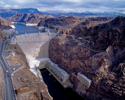 Hoover Dam on the Colorado River with snow on the mountains in the background. This photo was taken in 2008.