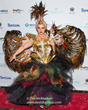 "Summer Strand  in Couture outfit titled ""Phoenix Rising"" a metaphor for animal rescue."