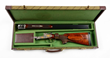 Cased Engraved and Inlaid Franz Sodia .458 Win Mag SxS Double Rifle, estimated at $25,000-35,000.