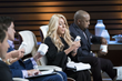 Shark Tank star, Lori Greiner, looking at a bottle of Thrive Plus.