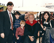 Jerry Falwell, Jr., his wife, Becki Falwell, and their sons Trey and Wesley, with Billy Graham when he delivered the keynote Commencement address in 1997.