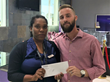 Employee in Grand Turk receives Diamonds International's relief funding from the General Manager
