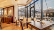 Warm interior, snow-covered exterior: The dining room of the Porta Caucasia hotel offers panoramic views of the Kazbegi Mountains, a popular skiing and hiking destination.