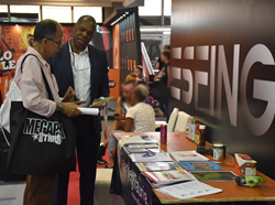 Greenberg Traurig Of Counsel Anthony Robinson speaks to an attendee at the Fifth Annual Expofitness International Sports and Wellness Business Expo.
