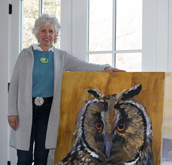 "Karen Kent holding 'Joia' a 48"" x 36"" mixed media painting. Photo by Daniel Samperi"