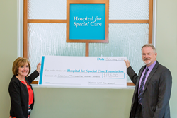 Kelser Corporation President and CEO Barry Kelly (right) presents check to Hospital for Special Care President and CEO Lynn Ricci (left) on behalf of the Kelser Foundation.