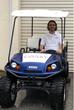 Dario Franchitti on a Coast Autonomous self-driving golf cart.