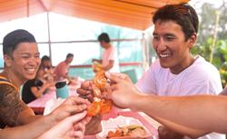 Enjoying Kahuku Garlic Shrimp on the Island and You tour