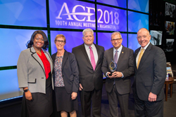 Stevens President Nariman Farvardin accepts the ACE/Fidelity Investments Transformation Award,