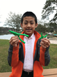 "Jason Qin, from Virginia Beach, VA and winner of the junior division for the ""Two for the Crew"" challenge poses with his award-winning design, ""2 Pliers + 1 Handle."""