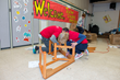 Teacher Created Materials staff build a reading bench for the playground at Carl E. Gilbert Elementary School