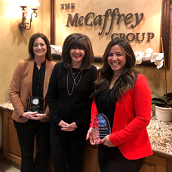 Photo of Shelly Hogan and Tina Akin of McCaffrey Homes Receiving Anniversary Service Awards from Karen McCaffrey of McCaffrey Homes in Fresno CA