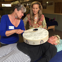 Anahata Ananda coaches a student using the Remo Buffalo Drum for vibrational sound healing.