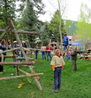 Kids from all around fill the famous Town Square lawn enjoying fun interactive and educational activities during ElkFest and Old West Days in Jackson Hole, Wyoming.