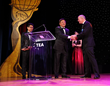 Chimelong Founder and Chairman Su Zhigang shakes hands with Ryan Miziker, Partner and Creative Director, Miziker Entertainment at the 2018 TEA Thea Awards, during the presentation of a Thea Award for