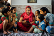 A mother in South Delhi reading to her kids and nephews using Worldreader's free Read to Kids application.
