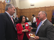 Bruce McCrary, Ridgefield Supply Company, Carrie Rand-Anastasiades, LDAC lobbyist, speak with Conn. State Senator Henri Martin.