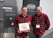 "Lumberjack System Co-Founders, Philip Hodgetts and Dr. Gregory Clarke, proudly their ""Best of Show Award"" at NAB 2018."