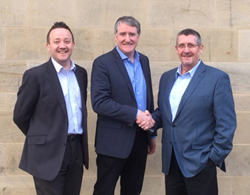Robert Anstruther CAD-IT's Director of Operations. Connell Gallagher, CAD-IT's VP SLM and Managing Director, and CaseBank's Steve Downie, VP International Sales, seal the partnership with a handshake.