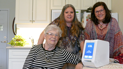 Sisters enjoy quality conversation time with their mother, thanks to the arrival of the spencer medication dispenser.