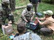 Yana DeMyer instructs troops in MVP-M™ water purification operation during a field exercise at JWA.