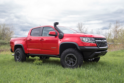 Chevrolet Colorado Accessorized with AEV Snorkel Kit and Crestone DualSport wheels.