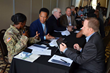Army Contracting Summit attendees participate in matchmaking sessions.