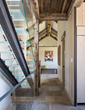A floating glass stairway leading to the master bedroom gets regional grounding from weathered timbers in this Wyoming home by JLF Architects and Big-D Signature builders (photo by Audrey Hall).