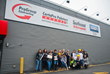 ProGroup's women in construction pose outside their new Headquarters in New Bedford, MA
