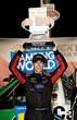 Rhodes Buckles Up Home Track Victory