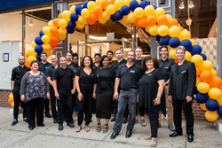 MyHome's team of designers, architects, and remodeling consultants gathers outside the newly remodeled Kitchen and Bath Showroom.
