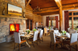 WRJ's Snake River Sporting Club dining room combines standout work from regional artists with sophisticated furnishings in inviting textures to complement rustic logs and stone (photo by David Swift).