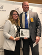 J.J. Hutzenbiler presents Emily Heller with Strengthen award