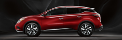 side view of red 2018 nissan murano