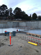 Forever waterproof: PENETRON ADMIX in soluble bags was added to all concrete for the below-grade retaining walls, the basement footings, and walls of the new Skyline Elementary School buildings.