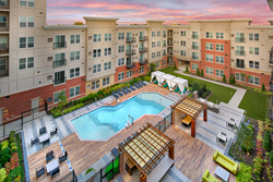 Sit poolside at The Remy Apartments