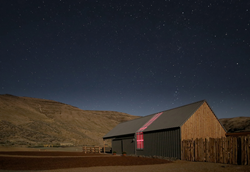 Cottonwood Canyon Experience Center under the starry skies of eastern Oregon in Cottonwood Canyon State Park.